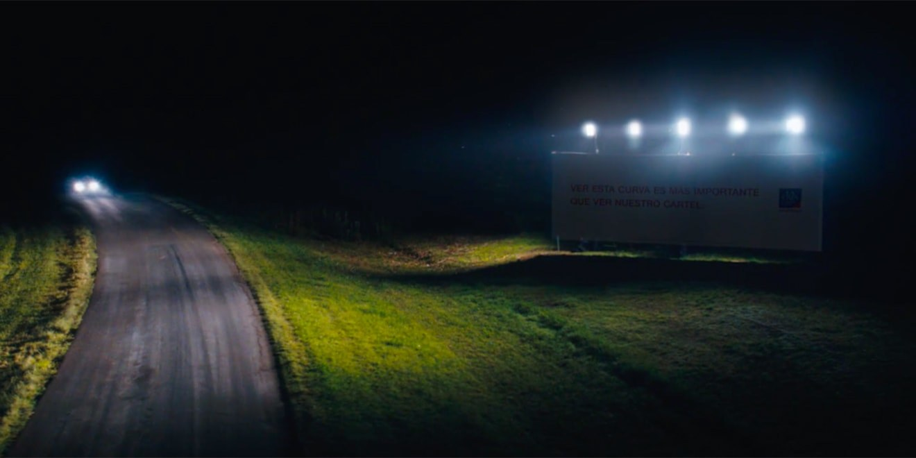 You Can't Read These Insurance Billboards at Night. They Light Up Dangerous Roads Instead